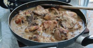 Chicken with white sauce in pan