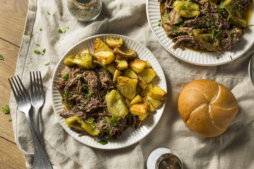mississippi pot roast served on table with bread