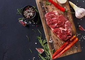 rib-eye-steak-and-spices-on-wood-at-black-1024x675-9348232